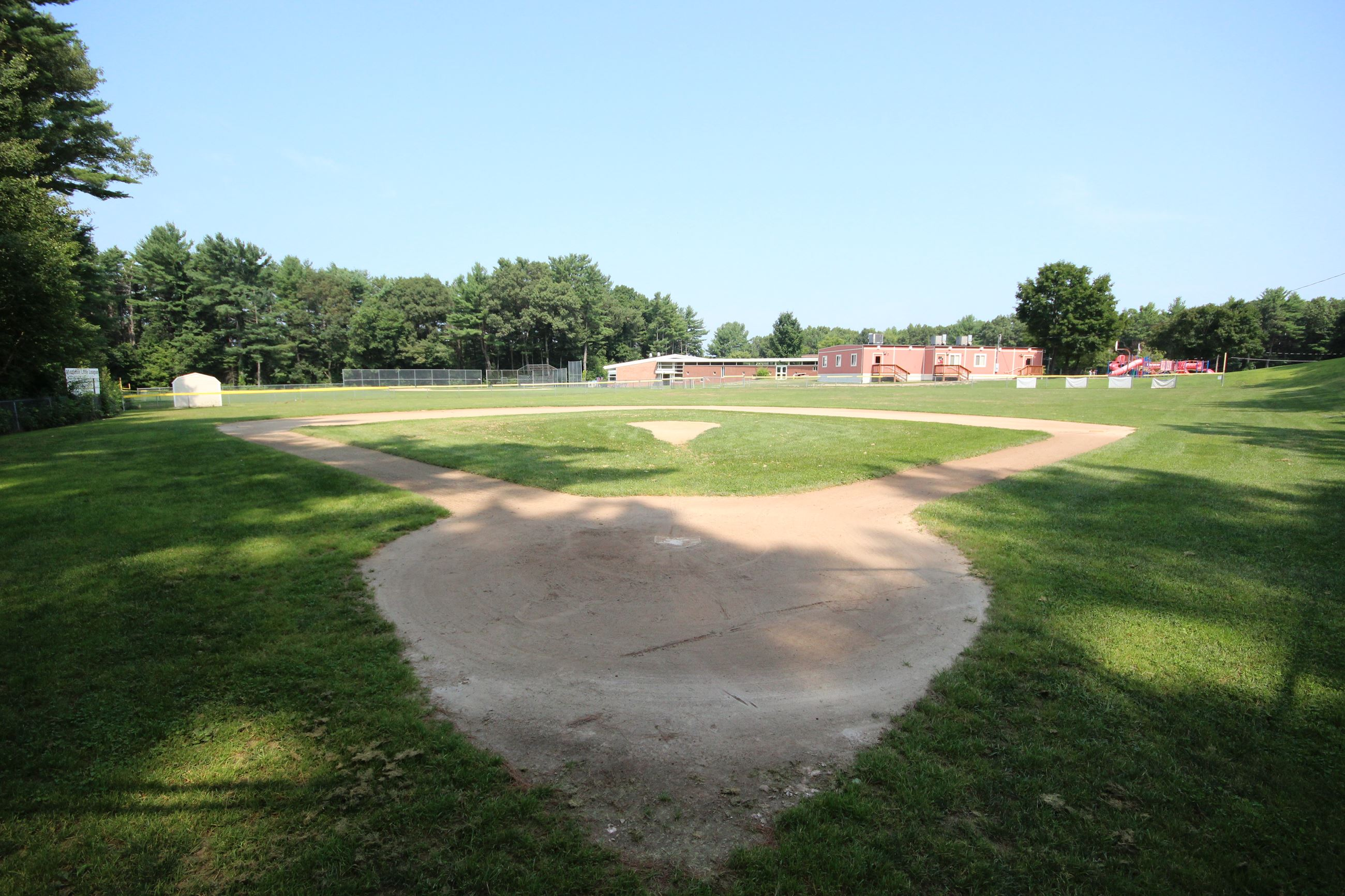 Fuller Meadow Baseball field with building in background